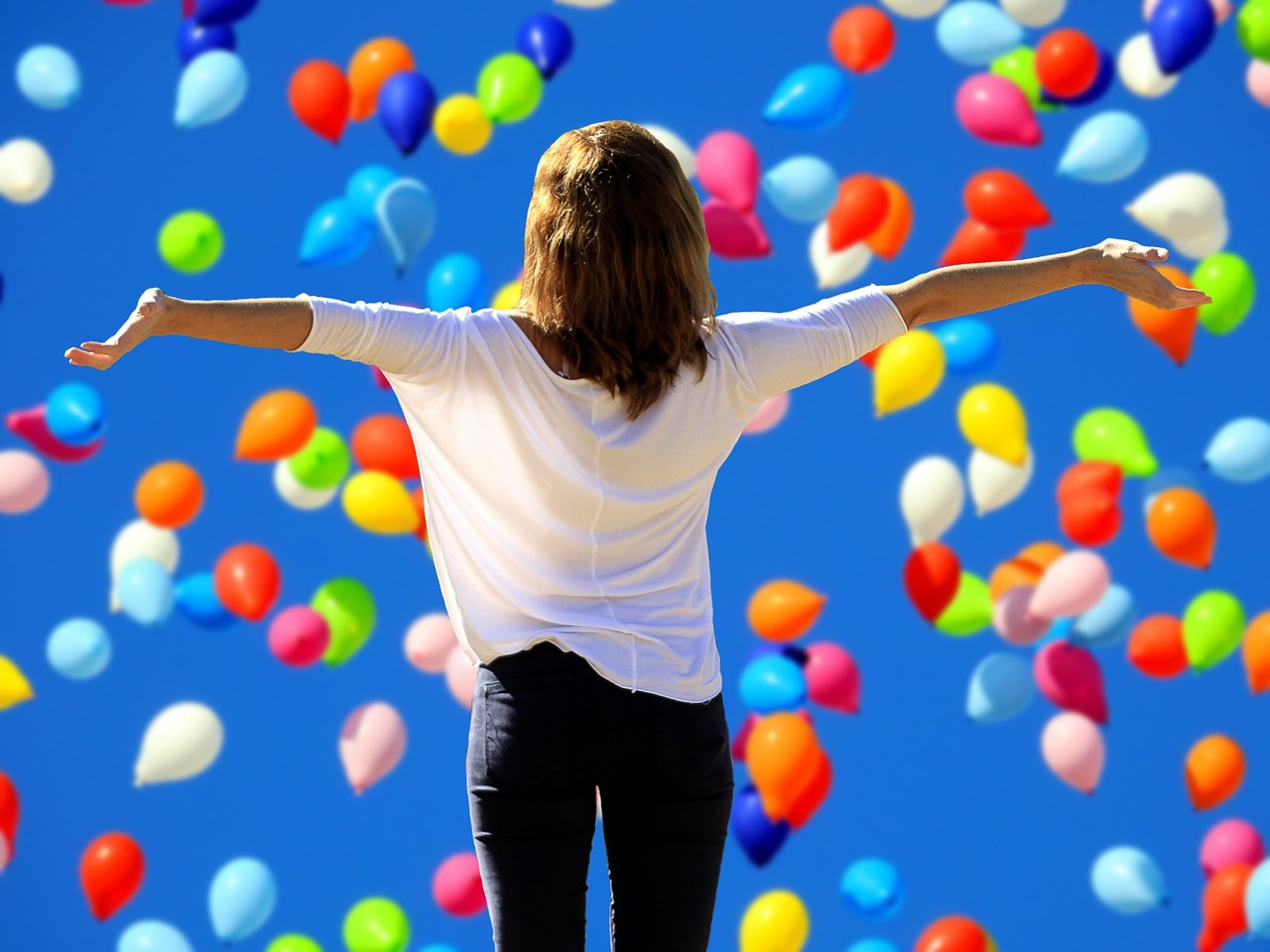 confident woman w balloons